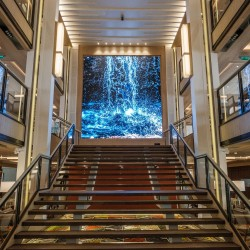 Stairs and large video screen inside the Atrium on-board the Viking Sea