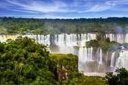 Grandiose multi-level waterfalls Iguazu in South America, on the border of three countries: Brazil, Argentina and Paraguay. Concept of active and extreme tourism